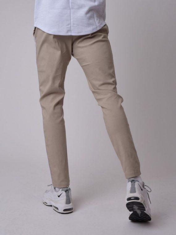 Pantalon basic cintré pipping contrasté côtés